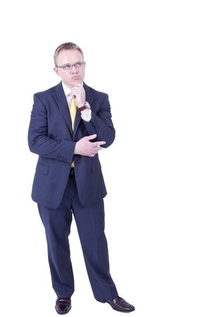 Sharp looking businessman thinking by looking up and his handon his chin. Stock Photo - 13081480