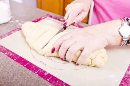 Cutting Turkish Pide pockets doughs. Stock Photo - 13110875