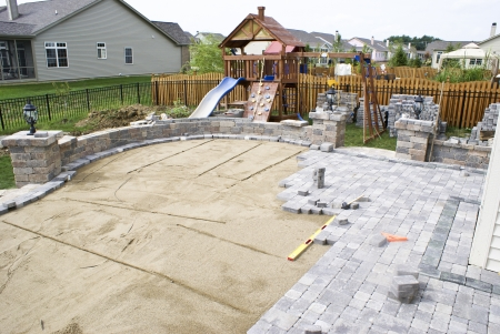 Paving patio on to levelled sand. Baxkyard Project.