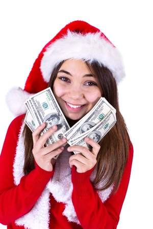 all in one: Santa Will Bring More Money  Teenager girl with Santas hat and holding her paycheck, all one hundred dollar banknotes  Isolated on white background  Stock Photo