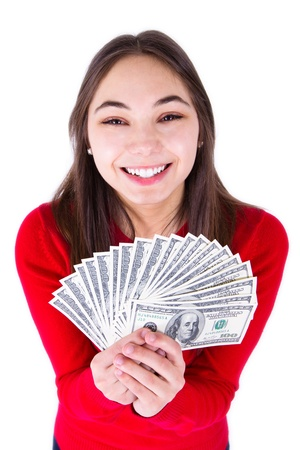 all in one: Teenager thrilled with money, holding big bucks in her hands happily, all one hundred dollar banknotes  Isolated on white background  Stock Photo