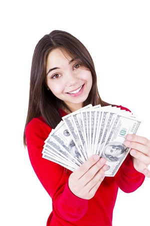 Slim sweet looking girl wishing more money with money in her hands  In red catchy sweater, isolated on white background  Stock Photo