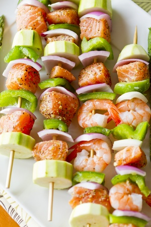 prawn skewers: Salmon cubes and Shrimp complimented with vegetables on skewers. Ready to cook. Red onions, zuccini and green peppers.