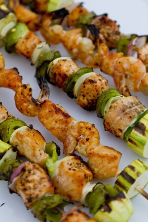 Freshly cooked salmon fish kebabs on the plate ready to eat. photo
