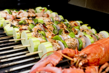 prawn skewers: Salmon and Vegetable Skewers and Lobster are on the barbecue.