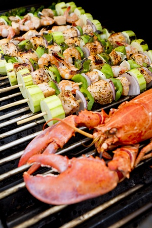 prawn skewers: Salmon Skewers and Lobster are on the barbecue.