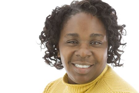 African American lady looking at camera with satisfied smile. Close up portrait.