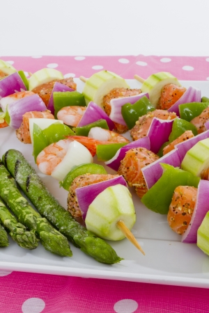 prawn skewers: Salmon cubes and Shrimp complimented with vegetables on skewers. Ready to cook. Red onions, zucchini, green peppers and asparagus.