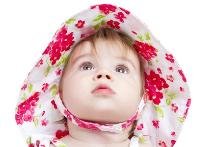 Baby with beautiful brown eyes looking up perhaps to see her future. Stock Photo - 14260882