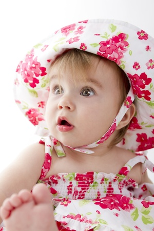 Baby surprised  by something perhaps her fathers studio lights. Stock Photo - 14260835