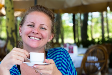 happier: Nothing makes me happier  than a cup of Turkish coffee in the mornings. A large smile comes from a Turkish girl. Stock Photo