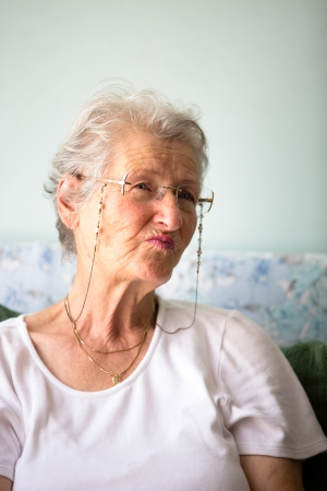 wise woman: White hair old lady giving pernickety look. Stock Photo
