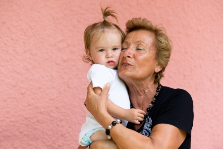 grandkid: Grandmother loves her grandkid while showing her true feelings  Stock Photo
