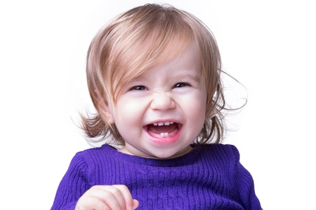 Happy baby is laughing fearless and freely with her new teeths, looking in to camera. Isolated on white.