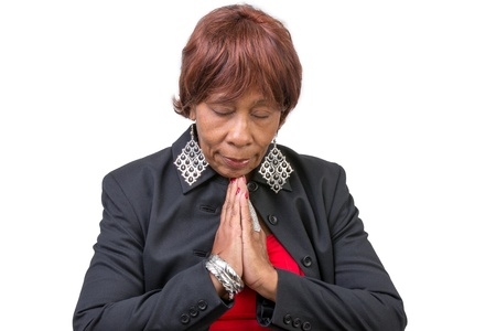 Clean wealthy woman praying deeply with her eyes closed. Isolated on White. Stock Photo - 17050681