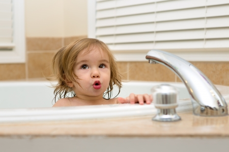 Toddler girl giving expression that needs hot water to take her bath Stock Photo - 18162542