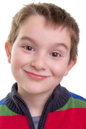 Kid smiling mischievously happy, perhaps just did something wrong. Stock Photo - 18358142