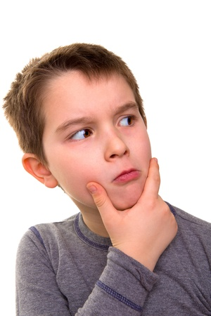 Kid giving a suspicious look. Wonder what he thinks. Stock Photo