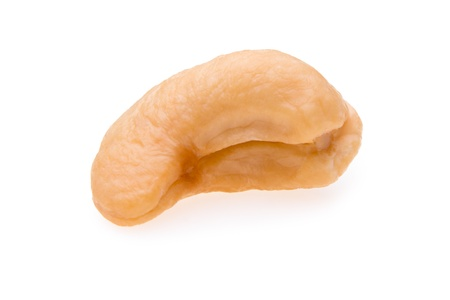 consume: Single cashew waiting to be consume. Isolated on white background. Stock Photo