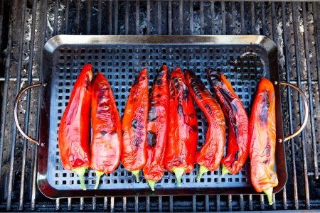 capsicums: Eight pieces of grilled chili placed on a rectangular tray in the barbecue.