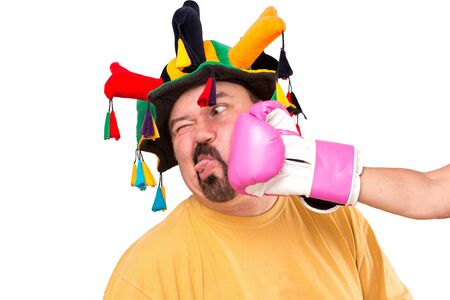 humiliation: A jokester man got smashed by strong boxer, he is looking at copy space, isolated on white
