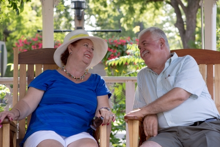Senior couple looking at each other with trust and love photo