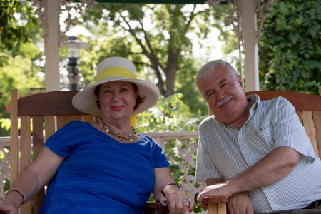 Senior couple looking at camera with trust photo