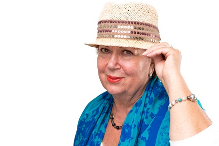 Senior woman posing with her fancy straw hat, she has blue color scarf on her shoulders