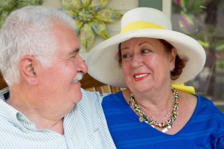 unworried: Some marriages last longer when you dont take the life too serious. Older couple looking at each other. Stock Photo
