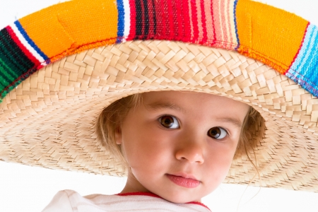 mexican sombrero: Welcome to Mexico says little girl with her Mexican hat and big brown eyes Stock Photo