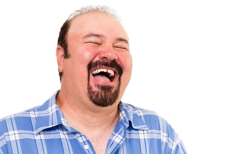 merriment: Big man having a hearty laugh of enjoyment and merriment with his head thrown back and eyes closed, isolated on white