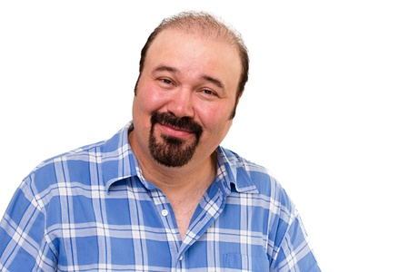 amused: Overweight man with a goatee beard looking at the camera with an amused kindly expression isolated on white