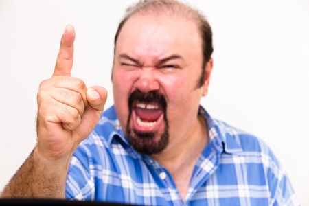 Horizontal portrait of an angry middle-aged Caucasian man screaming and threatening, isolated on white background