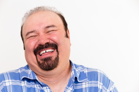 Close-up horizontal portrait of a cheerful middle-aged Caucasian man laughing loud, isolated on white background