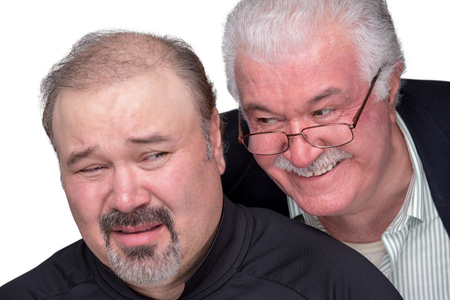 Older man got in to personal space of a younger man. Younger man showing his emotions with unpleasent face Stock Photo