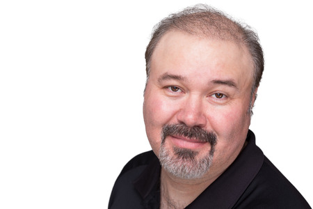 Middle aged man with his goatee looking at camera trustfully and satisfied photo