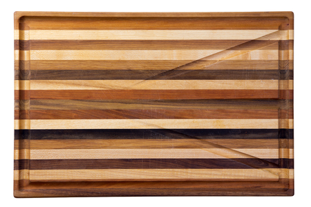 grooves: Multicolor wooden cutting board with grooves for water collection Stock Photo