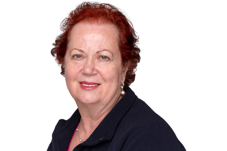 congenial: Red hair senior lady looking at camera trustfully Stock Photo