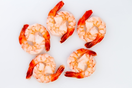 eachother: Ten cooked cocktail tiger shrimps are partnered with eachother to create ying yang design