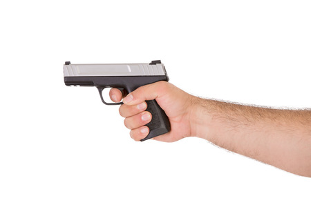 gatillo: Disparar estilo con un arma de la mano desde el interior de la vista del brazo Foto de archivo