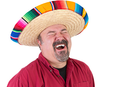 Happy guy with sombrero hat laughing out loud with his eyes closed