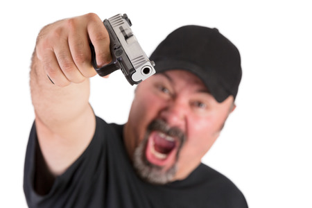 handguns: Big man with goatee points his gun to you with a loud scream, make sure do whatever he says, stop thinking, focus on the gun, isolated on white Stock Photo