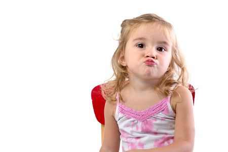 Toddler girl very bored her lips and shoulders are showing the the boredom