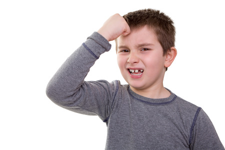 Kid knocking his head  looks very regretful about what he did