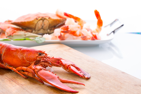 feast: Preparing dungeness crab, red lobster and shrimps in the kitchen on the cutting board