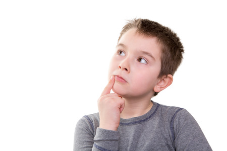 educational problem solving: Young boy pushing the limits of his thought process, isolated on white