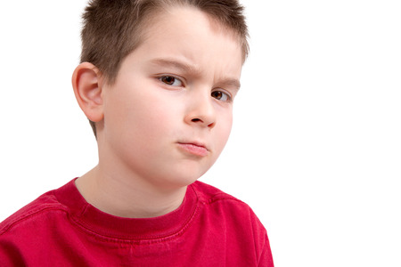 scowl: Young boy frowning at you unappreciatively, you better to listen what he asks