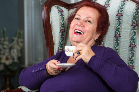 Senior Woman having good time while having her Turkish Coffee  photo