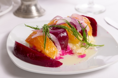 strained: Strained yogurt labneh citrus salad with pickled beets and peeled oranges garnished with onions and dill served with oil Stock Photo