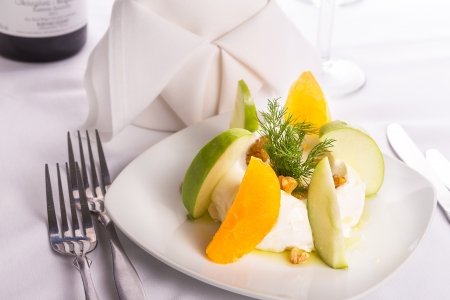 zesty: Strained yogurt labneh citrus salad with peeled oranges and green apples garnished with dill and walnuts served with oil